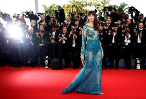 "Actress Frederique Bel poses on the red carpet as she arrives for the opening ceremony and the screening of the film ""La tete haute"" out of competition during the 68th Cannes Film Festival in Cannes, southern France, May 13, 2015. The 68th edition of the film festival will run from May 13 to May 24.              REUTERS/Eric Gaillard  TPX IMAGES OF THE DAY"