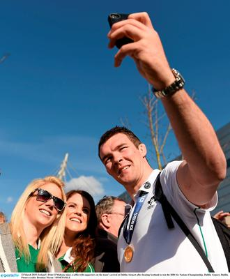 22 March 2015; Ireland's Peter O'Mahony takes a selfie with supporters on the team's arrival at Dublin Airport after beating Scotland to win the RBS Six Nations Championship. Dublin Airport, Dublin. Picture credit: Brendan Moran / SPORTSFILE