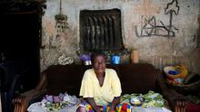 A woman sits in front of her home, once occupied by Boko Haram in Michika town, after the Nigerian military recaptured it from Boko Haram, in Adamawa state May 10. Reuters/Akintunde Akinleye