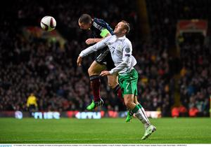 Aidan McGeady, Republic of Ireland, in action against Scott Brown, Scotland. UEFA EURO 2016 Championship Qualifier, Group D, Scotland v Republic of Ireland, Celtic Park, Glasgow, Scotland. Picture credit: David Maher / SPORTSFILE