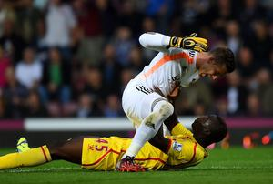 West Ham United goalkeeper Adrian clashes with Mario Balotelli during Liverpool's defeat at Upton Park. Photo: Mike Hewitt/Getty Images