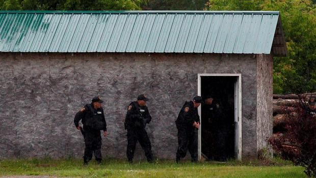 Large numbers of officers converged on Tuesday on the town of Willsboro, about 40 miles (64 km) south of the Clinton Correctional Facility in Dannemora, New York, from which two convicted murderers had escaped, following a reported sighting of the pair. Photo: Reuters