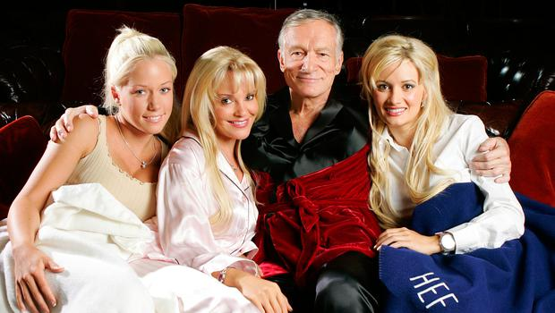 Hugh Hefner poses with Kendra Wilkinson (L) Bridget Marquardt and Holly Madison (R)  before a screening of Bonnie and Clyde at the Playboy Mansion June 18, 2004 in Los Angeles, California.  (Photo by Carlo Allegri/Getty Images)