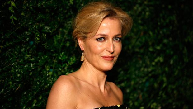 US actress Gillian Anderson, shortlisted for the best actress award, poses on the red carpet as they attend the 60th London Evening Standard Theatre Awards 2014 in London on November 30, 2014. AFP PHOTO / JUSTIN TALLIS        (Photo credit should read JUSTIN TALLIS/AFP/Getty Images)