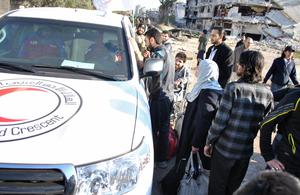 Civilians wait to be evacuated by United Nations (UN) staff, from the besieged district of the central Syrian city of Homs to a safer location, on February 9, 2014.