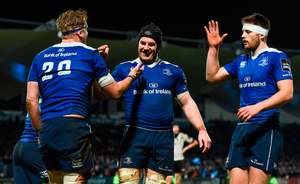 Jamie Heaslip, left, is congratulated by his Leinster team-mates Sean O'Brien and Ross Byrne, right, after scoring his side's tenth try. Photo: Sportsfile