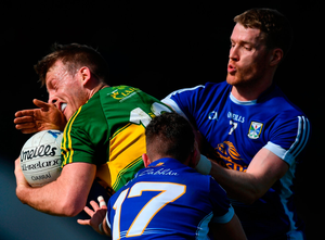 Kerry's Donnchadh Walsh collides with Rory Dunne of Cavan. Photo: Stephen McCarthy/Sportsfile