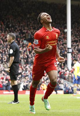 Liverpool's Raheem Sterling celebrates scoring his teams fifth goal of the game during the Barclays Premier League match at Anfield, Liverpool. PRESS ASSOCIATION Photo. Picture date: Saturday February 8, 2014. See PA story SOCCER Liverpool. Photo credit should read: Peter Byrne/PA Wire. RESTRICTIONS: Editorial use only. Maximum 45 images during a match. No video emulation or promotion as 'live'. No use in games, competitions, merchandise, betting or single club/player services. No use with unofficial audio, video, data, fixtures or club/league logos.