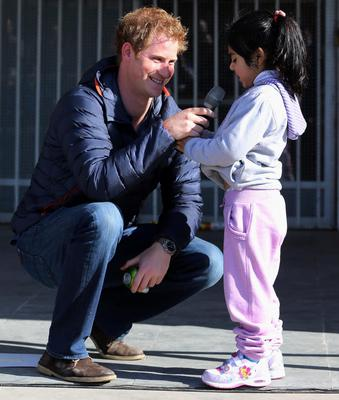 Pascal Vasquez, 7, steals the microphone from Prince Harry as he meets children with mental and physical disabilities at the Fundacion Amigos de Jesus in Santiago Chile