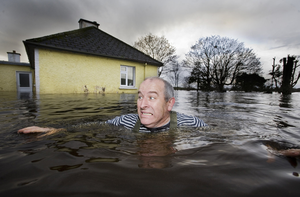 Flashback: Hughie O'Donnell up to his neck in the flood in 2009. Photo: Mark Condren