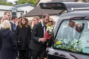 Ana Hick's father Tim places flowers in the back of the hearse at her funeral mass in the Church of the Assumption, Dalkey  Pic:Mark Condren 20.5.2015