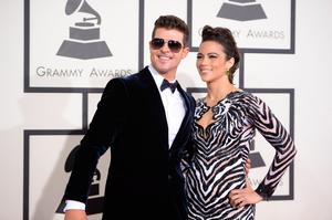 """Nominee For Best Pop Vocal Album for """"Blurred Lines"""" Robin Thicke (L) and actress Paula Patton arrive on the red carpet for the 56th Grammy Awards"""