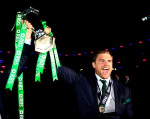 Jamie Heaslip celebrates with the trophy.  (Photo by Richard Heathcote/Getty Images)