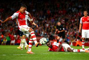 Arsenal's Alex Oxlade-Chamberlain scores his team's first goal during the match between Arsenal and Tottenham Hotspur at the Emirates Stadium. Paul Gilham/Getty Images