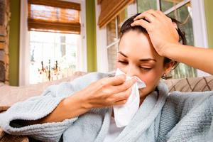 Symptoms like a sore throat, fever and muscle ache and a feeling of being very unwell will develop in the first 24 to 48 hours and come on more suddenly than typical cold symptoms. (picture posed)