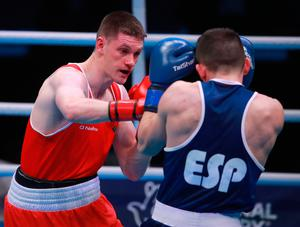 Ireland's George Bates (red) defeats Spain's Leon Becerra Dominguez (blue) during day two of the Boxing Road to Tokyo 2020 Olympic qualifying event at the Copper Box Arena, London.