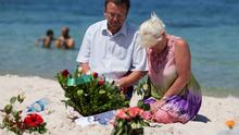 Tourists mourn at the site of the terrorist attack in Sousse, Tunisia, in which 38 people, including three Irish holidaymakers, were killed