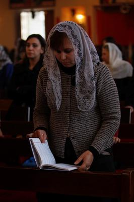 Iraqi Christians attend mass on Christmas at St. Joseph Chaldean Church in Baghdad, December 25, 2013. REUTERS/Ahmed Saad  (IRAQ - Tags: RELIGION SOCIETY)