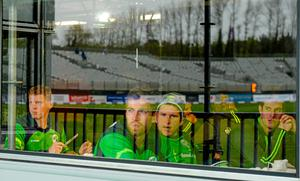 Ireland players look on as the rain falls in Malahide during yesterday's aborted One-Day International