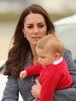 Prince George is seen in the arms of his mum, Kate Middleton, in Canberra, Australia. (Photo by Danny Martindale/WireImage)