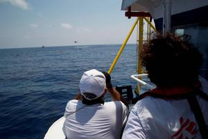 MSF Field coordinator Juan and first officer Porfirio follow the rescue operation involving ships and sea rescue helicopters scanning the area to spot survivors in the water 05 August. A boat carrying migrants had capsized and sank with many feared drowned.  (Photo: Marta Soszynska/MSF)