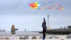 Passing the time: Emma Murphy (8) tries to keep her kite away from her brother, Sean (10), on Dollymount Strand, Dublin. Photo: Frank McGrath
