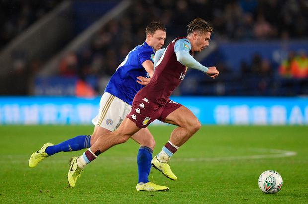 Leicester City's Jonny Evans and Aston Villa's Jack Grealish battle for possession. Photo: Getty Images