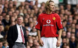 David Beckham and his Manchester United manager Alex Ferguson look in different directions in 2003