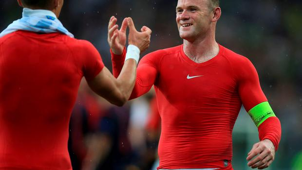 England's Wayne Rooney (right) during the UEFA European Championship Qualifying match at the Stozice Stadium, Slovenia. PRESS ASSOCIATION Photo. Picture date: Sunday June 14, 2015. See PA story SOCCER Slovenia. Photo credit should read: Mike Egerton/PA Wire. RESTRICTIONS: Use subject to FA restrictions. Editorial use only. Commercial use only with prior written consent of the FA. No editing except cropping. Call +44 (0)1158 447447 or see www.paphotos.com/info/ for full restrictions and further information.