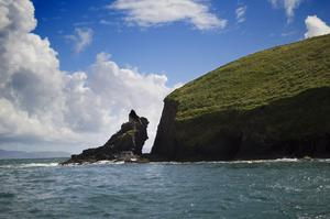 A sea stack in Dingle, captured against blue skies and blue water by Brian Cassidy.