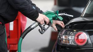 CONSUMERS are getting a raw deal due to the failure of energy suppliers and petrol and diesel retailers to pass on massive falls in their costs (Lewis Whyld/PA)