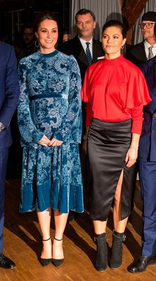 Kate Middleton and Crown Princess Victoria attend a reception at the Fotografiska Galleries in Stockholm on Day 2 of the Duke and Duchess of Cambridge's visit to Sweden. Photo: Dominic Lipinski/PA Wire