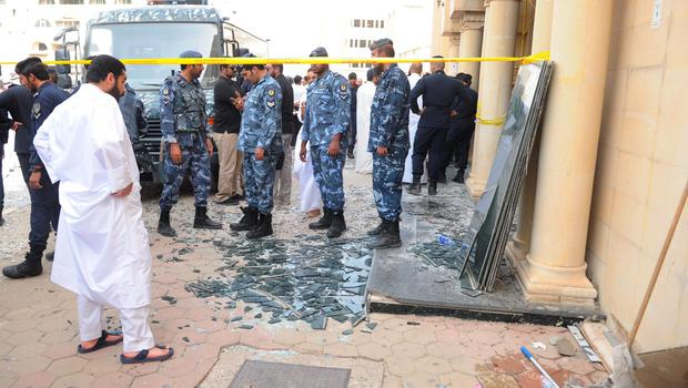 Security forces work at the site of a deadly blast claimed by the Islamic State group that struck worshippers attending Friday prayers at a Shiite mosque in Kuwait City, Friday, June 26, 2015. Friday's explosion struck the Imam Sadiq Mosque in the neighborhood of al-Sawabir, a residential and shopping district of the capital. (AP Photo)