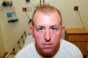 St. Louis County Prosecutor's Office photo shows Ferguson, Missouri police officer Darren Wilson photo taken shortly after August 9, 2014 shooting of Michael Brown, presented to the grand jury and made available on November 24, 2014.   REUTERS/St. Louis County Prosecutor's Office/Handout via Reuters