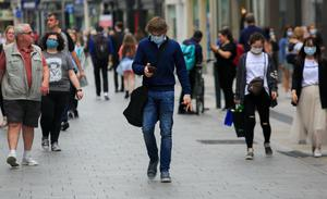 People wearing facemasks on Grafton Street Dublin during the Covid 19 coronavirus pandemic. Photo: Gareth Chaney/Collins