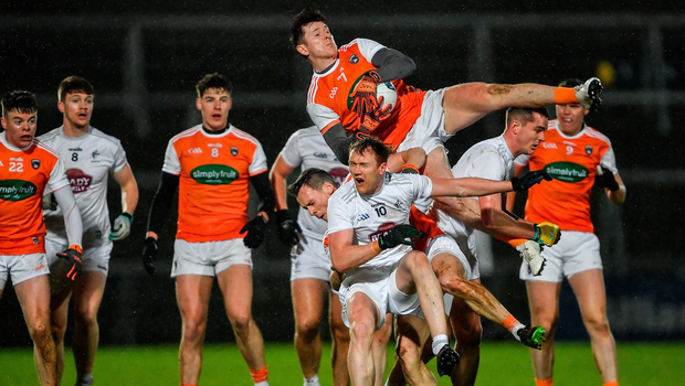 Armagh's Joe McElroy jumps into action to win possession ahead of team-mate Mark Shields and Kildare's Paul Cribbin at the Athletic Grounds, Armagh. Photo by Piaras Ó Mídheach/Sportsfile