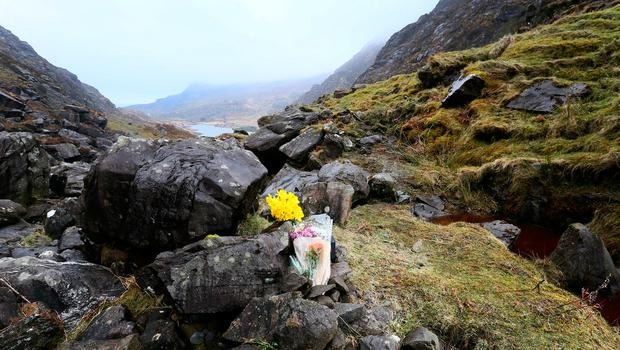 Flowers at the scene on the Gap of Dunloe where American tourists Roselyn Joy Few and Normand Larose were killed in a tragic accident