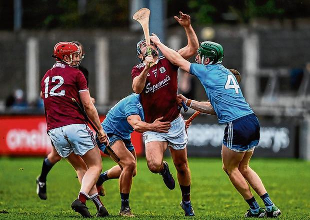 Dublin duo James Madden (r) and Cian Boland get up close and personal with Galway's Johnny Coen. Photo by Harry Murphy/Sportsfile