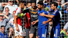 Arsenal defender Gabriel (L) and Chelsea's Diego Costa (2nd R) are separated by Arsenal goalkeeper Petr Cech (C) after clashing last Saturday