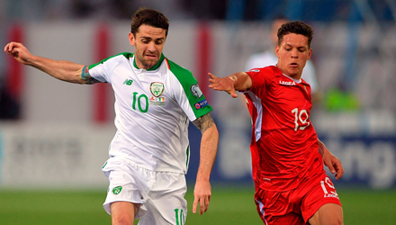 Ireland's Robbie Brady and Gibraltar's Tjay De Barr battle for the ball  at the Victoria Stadium. Photo: Simon Galloway/PA