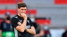 Rangers manager Steven Gerrard watches on during his side's defeat to Bayer Leverkusen. Martin Meissner/PA Wire via DPA.