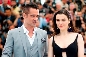 """Irish actor Colin Farrell (L) and British actress Rachel Weisz pose during a photocall for the film """"The Lobster"""" at the 68th Cannes Film Festival"""