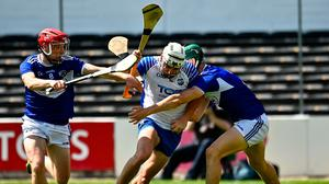 Dessie Hutchinson of Waterford in action against Fiachra C Fennell and Sean Downey of Laois during the All-Ireland SHC qualifier at UPMC Nowlan Park in Kilkenny. Photo: Harry Murphy/Sportsfile
