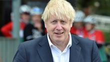 British Prime Minister Boris Johnson speaks to local people at a heritage centre in Beeston near Nottingham, England, July 28, 2020. Rui Vieira/Pool via REUTERS/File Photo