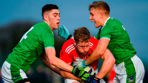Ruairi Deane of Cork is tackled by Paul Maher left, and Gordon Brown of Limerick. Photo by Ramsey Cardy/Sportsfile