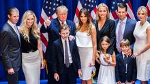 (L-R) Eric Trump, Lara Yunaska Trump, Donald Trump, Barron Trump, Melania Trump, Vanessa Haydon Trump, Kai Madison Trump, Donald Trump Jr., Donald John Trump III, and  Ivanka Trump pose for photos on stage after Donald Trump announced his candidacy for the U.S. presidency at Trump Tower on June 16, 2015