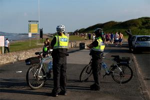 Gardai investigate a riot between two groups of youths at Portmarnock beach, Dublin. Photo: Collins