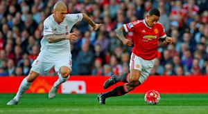 Liverpool's Martin Skrtel in action with Manchester United's Memphis Depay. Photo: Reuters / Phil Noble