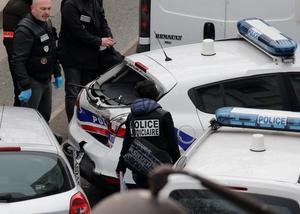 Police inspect damage after a collision between police cars at the scene after a shooting at the Paris offices of Charlie Hebdo, a satirical newspaper, January 7, 2015. REUTERS/Christian Hartmann
