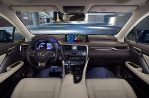 The Lexus RX450h's cabin decked out in rich cream leather